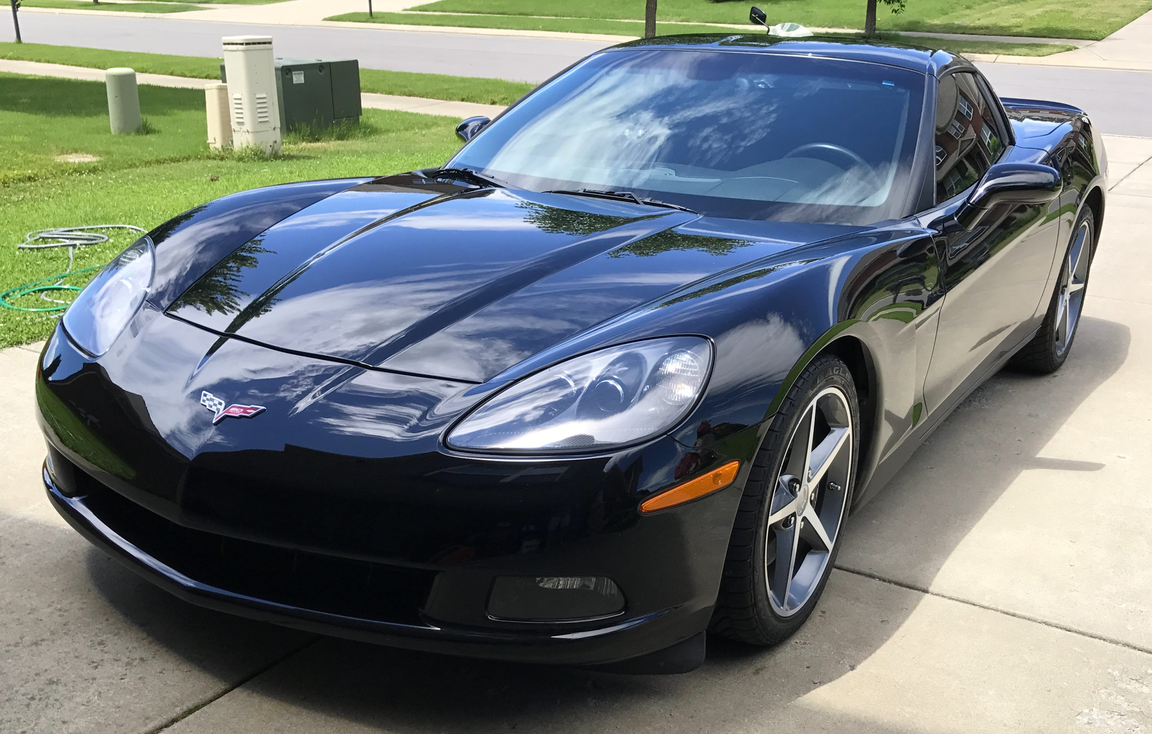 "Scott Kolecki, content writer and Corvette enthusiast, preps his car for ""Drive Your Corvette To Work"" Day on Friday, June 30, 2017."