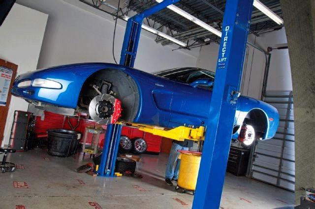 Blue Z06 Corvette on a lift