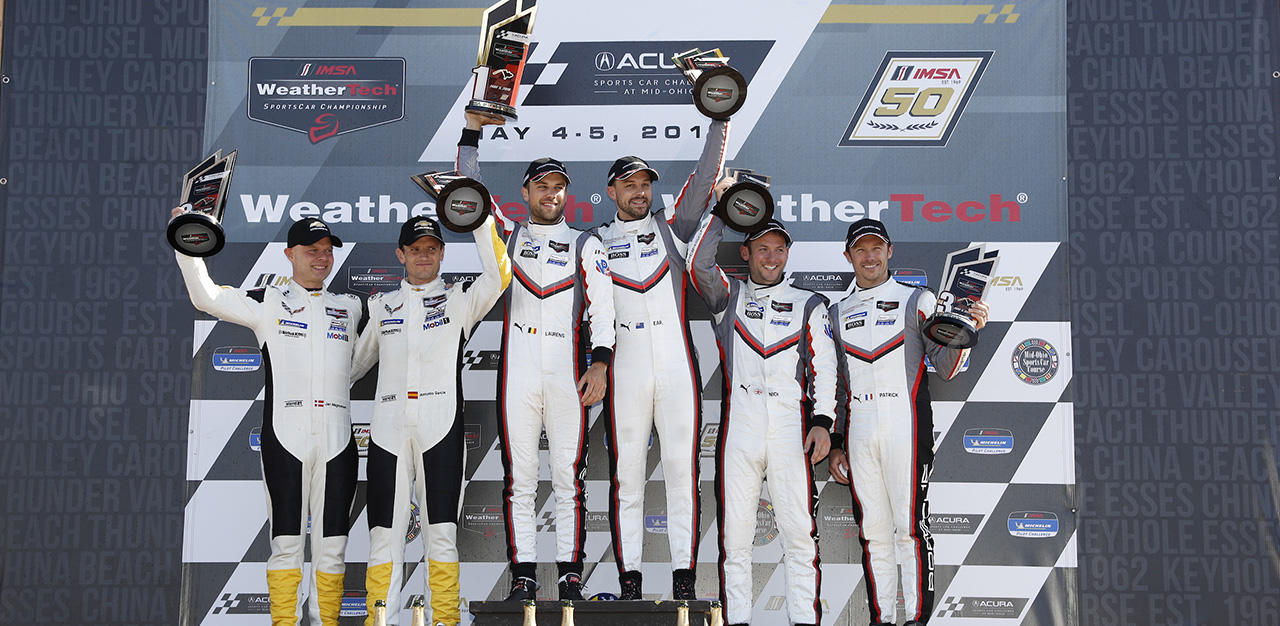 Jan Magnussen and Antonio Garcia on the podium at Mid-Ohio