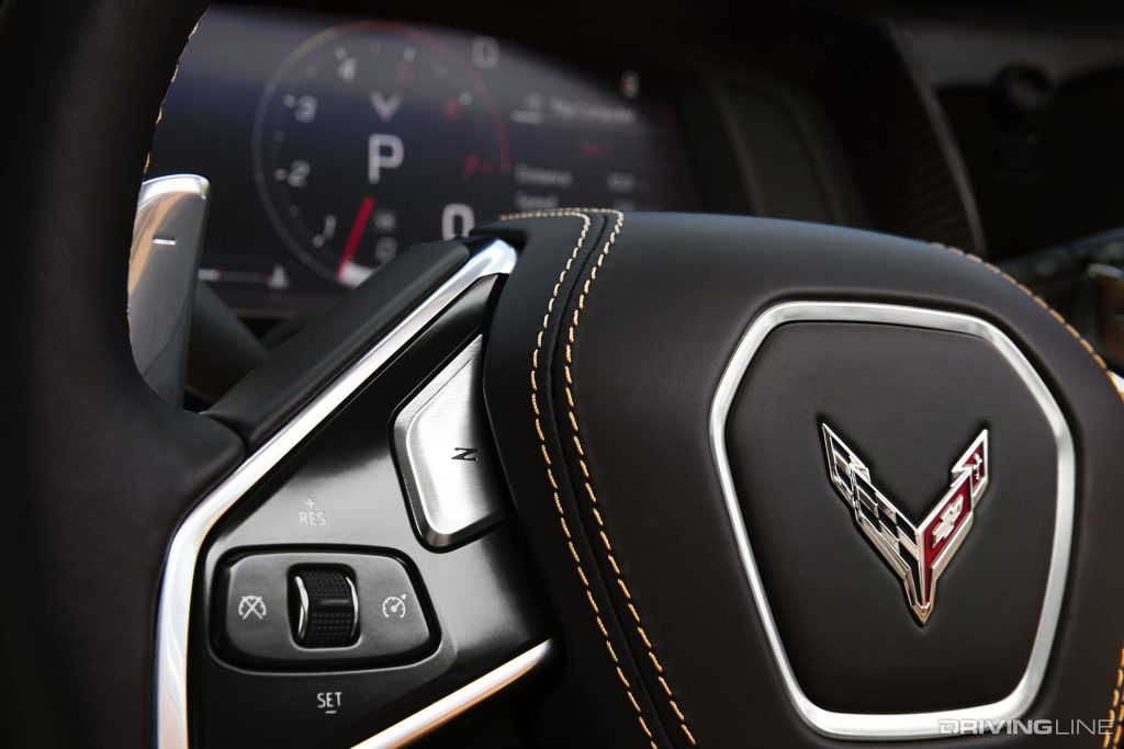 "The 2020 Mid-Engine Corvette Stingray features paddle shifters that provide the driver with shift control over the car's automatic transmission. Also, please note the ""Z"" button on the steering wheel as well as the yellow-stitching on the steering wheel. Both of these are options available to consumers when purchasing a new C8 Corvette."