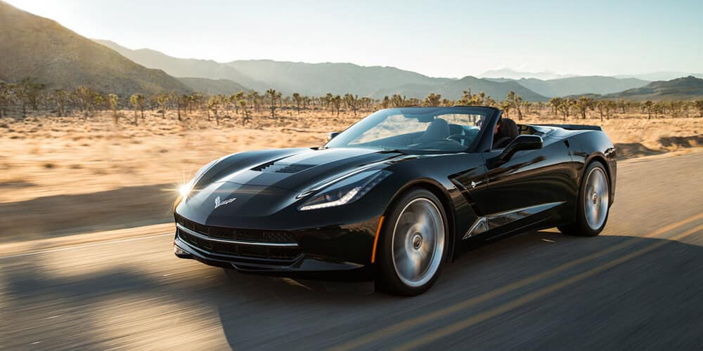 The 2018 Corvette Convertible finished in Black. Note the larger front and rear wheels.