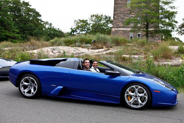 Nick riding shotgun in a Lamborghini Murcielago.