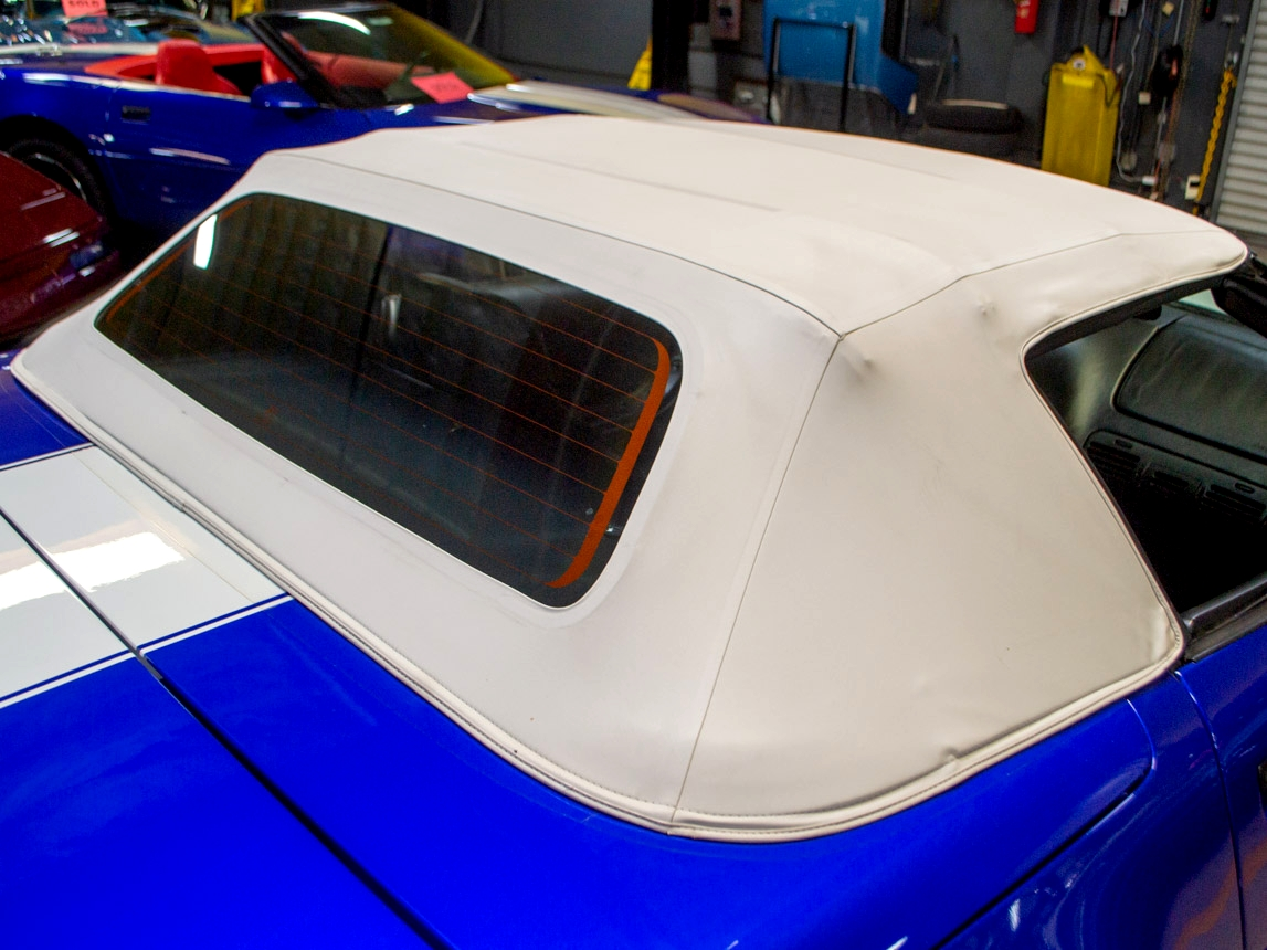 Note the condition of this convertible top - while it should be expected on a low-mileage car like this, the condition of the top is all the more impressive because it has retained its factory white color.