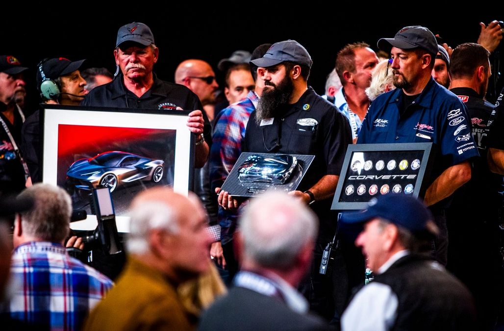In addition to the car, Hendrick will receive the framed art and memorabilia that accompanied the car across the block.