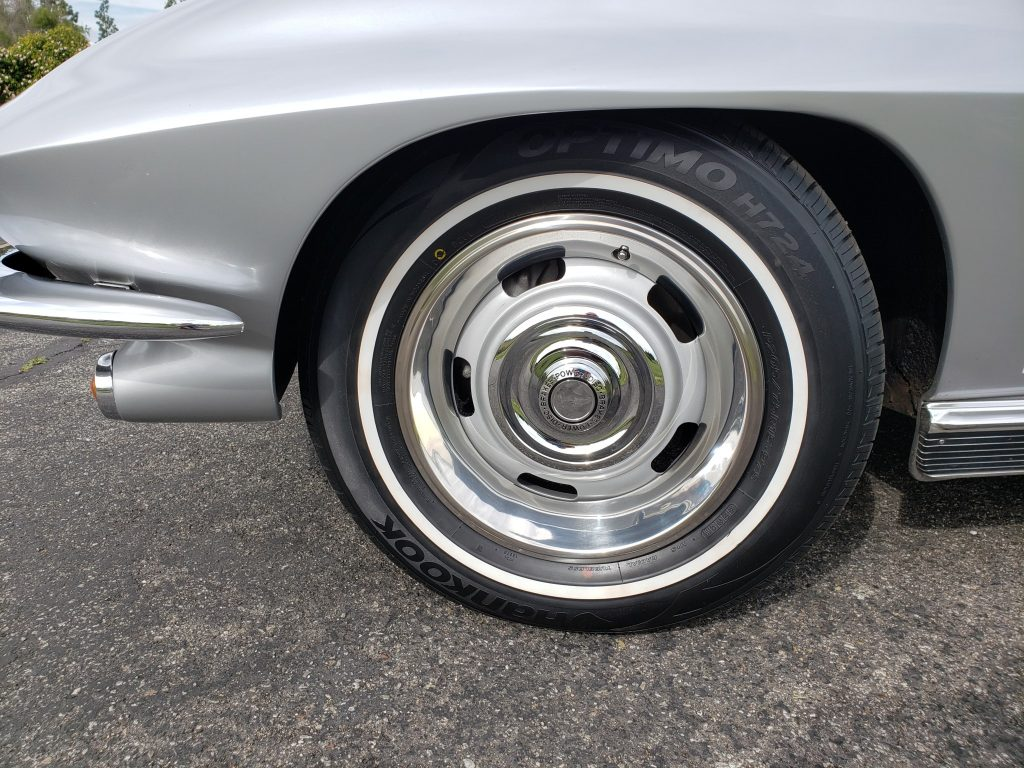 The wheels of this 1966 Corvette are wrapped in whitewall Hankook tires.