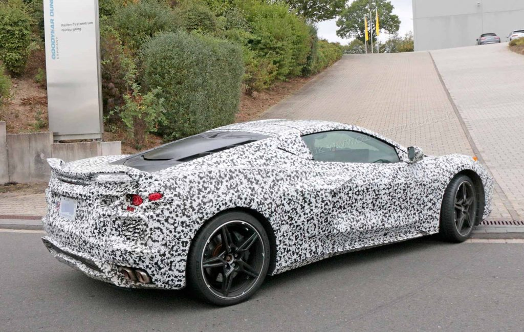 Spy photo of a C8 Corvette test-mule pulling into a GM testing center.