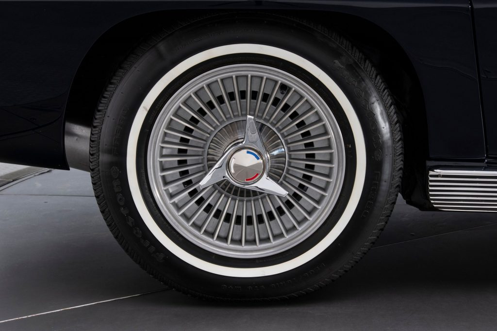 The 15-inch wheels on this car are wrapped in Firestone rubber and appear to be in like-new condition.