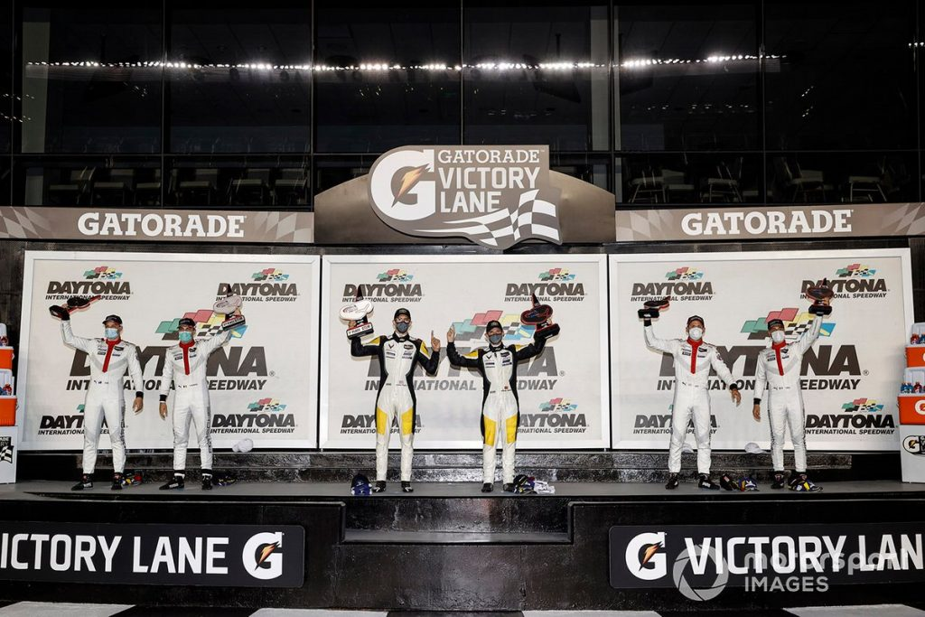 Jordan Taylor and Antonio Garcia (center) take first place in the GTLM class of the Daytona 240 on July 4, 2020.
