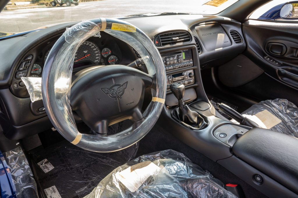 This car's interior has never been unpackaged from the factory.