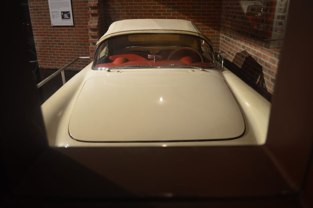 Richard Sampson's 1954 Corvette on display at the National Corvette Museum as seen thru the recreation of the original viewport built into the wall at Sampson's grocery store.