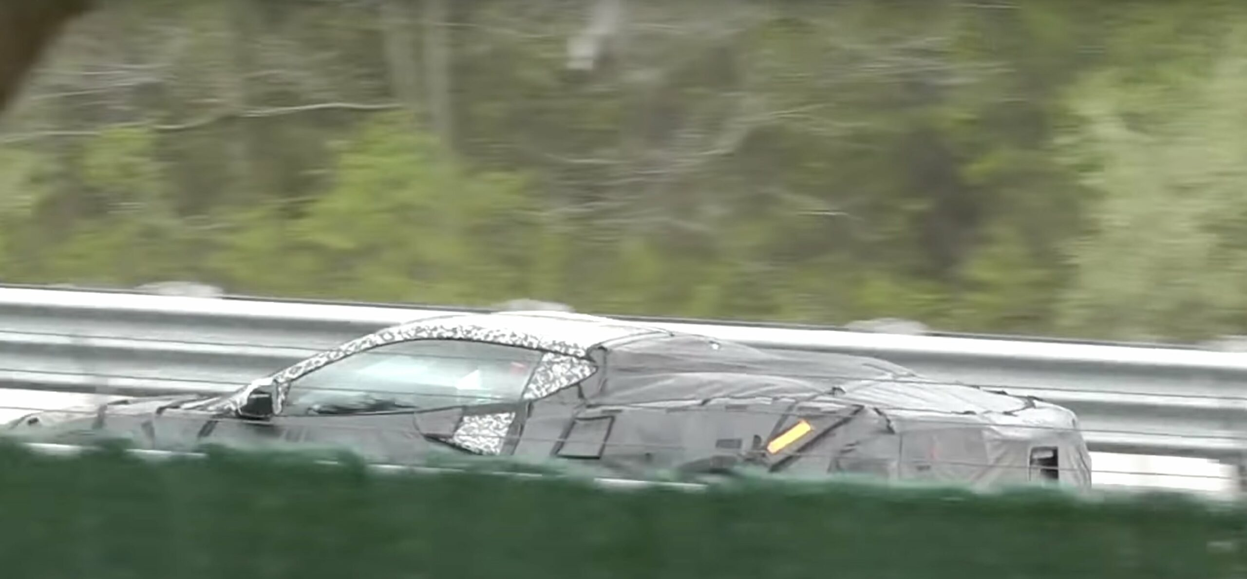 A side view of a new Corvette - possibly the 2023 C8 Z06