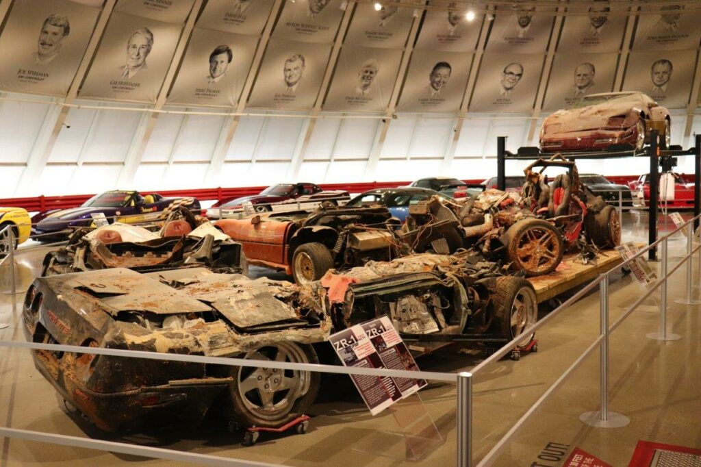 The sinkhole Corvettes on display in the restored rotunda at the National Corvette Museum. The Mallett Hammer Z06 is to the right in this image.