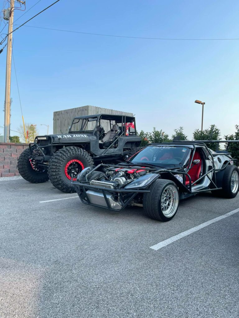 """Mike Mahdi's """"Mad Max"""" Stingray parked next to another of his amazing transformations. Clearly, this guy believes in subtlety!"""