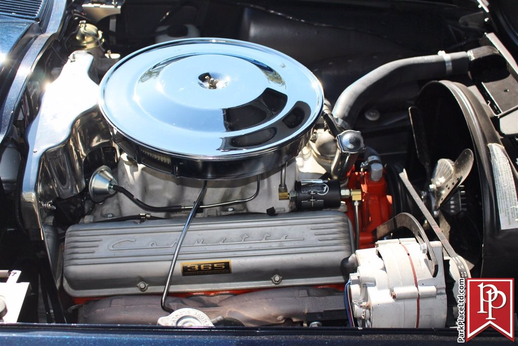 Close-up of 1964 L76 Engine in open hood with Corvette branding