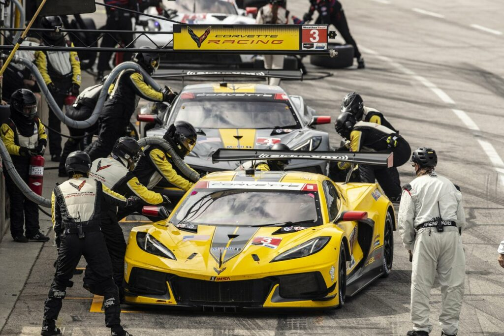 Both C8.R's of Corvette Racing pit during the race's single full-course caution.